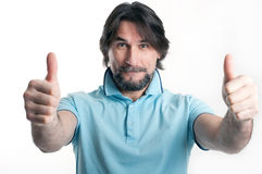Man shows a sign of okay. On a light background Royalty Free Stock Image