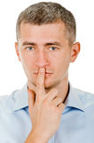Man shows sign of silence Royalty Free Stock Photos