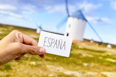 Man shows a signboard with the word Espana, Spain, in front of t Royalty Free Stock Photo