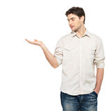 Man shows  something on palm  isolated on white Royalty Free Stock Photos