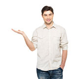 Man shows  something on palm  isolated on white Stock Photo