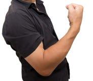 Man shows strength Stock Photos