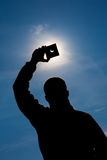 Man shows sun eclipse Royalty Free Stock Images
