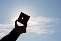 Man shows sun eclipse Stock Image