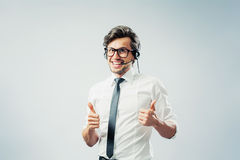 Man shows thumbs up. Callcenter operator gestures thumbs up Stock Image