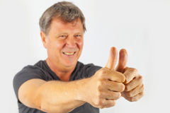 Man shows thumbs up Stock Images