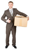 Man shows thumbs-up and holds cardboard box Royalty Free Stock Photo