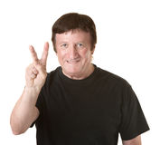 Man Shows Victory Symbol Stock Photo