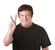 Man Shows Victory Symbol Stock Photo