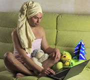 Man shows a woman at home on the computer Stock Photography
