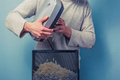 Man with shredder Stock Images