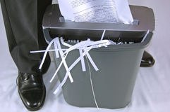 Man shredding paper. Business man shredding paper Royalty Free Stock Image