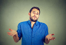Man shrugging shoulders who cares so what I don't know gesture Royalty Free Stock Photo