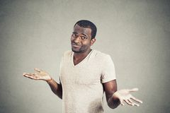 Man shrugging shoulders who cares so what I don't know gesture Royalty Free Stock Photos