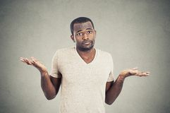 Man shrugging shoulders who cares so what I don't know gesture Stock Image