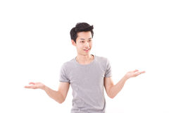 Man shrugging, white background Royalty Free Stock Image