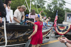 Man shucks oysters on a float in the Wellfleet 4th of July Parade in Wellfleet, Massachusetts. Stock Images