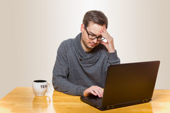 A man is sick of  problems with his laptop where he is working on Royalty Free Stock Photos