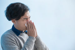 Man is sick and sneezing Royalty Free Stock Photo