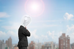 Man side view with lamp head thinking in sunny day Royalty Free Stock Images