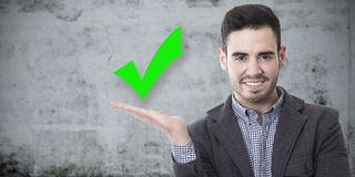 Man with sign approval. Man smiling with the sign of approval Stock Photo