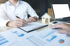 Man sign a home insurance policy on home loans stock photo