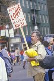 Man with sign during NY City Marathon Stock Photo