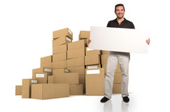 Man with sign and piles of boxes Royalty Free Stock Photos