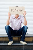 Man with a sign for sale Royalty Free Stock Photo