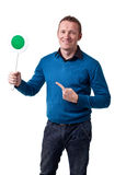 Man with signal. Portrait of man holding green signal stock images