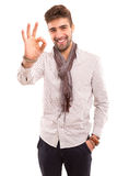 Man signaling ok Stock Images