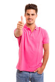 Man signaling ok. Handsome young man signaling ok, isolated over a white background Stock Image