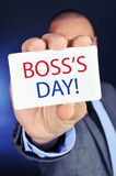 Man with a signboard with the text boss day Royalty Free Stock Photography