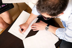 Man signing an agreement Stock Images