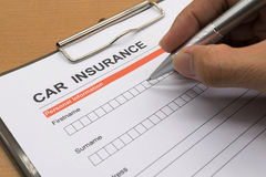 Man signing a car insurance policy Royalty Free Stock Images