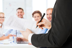 Man signing contract. Business concept - men signing contract Stock Photo