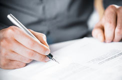 Man signing a contract or agreement Stock Photos