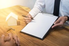 Man signing contract of loan agreement document with bank broker. Agent insurance, Real Estate concept Stock Images