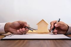 Man signing contract of loan agreement document with bank broker. Agent insurance, Real Estate concept Stock Image