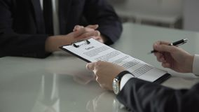 Man signing contract seeing money between pages, bribe, prosperity of corruption. Stock footage stock footage