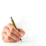 Man signing a document with a fountain pen Royalty Free Stock Photo