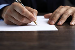 Man signing a document or writing correspondence Stock Photos