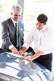 Man signing documents dealership Royalty Free Stock Images
