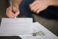 Man signing rental agreement, tenancy and rent concept, close up Royalty Free Stock Photography