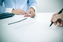 Man signing a resignation document Royalty Free Stock Images