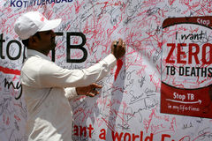 Man signing TB awareness program poster,Hyderabad,India. Indian Man signing TB awareness program signature campaign poster on June 5,2012 in Hyderabad,India royalty free stock images