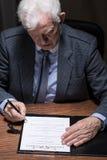 Man signing testament Royalty Free Stock Photos