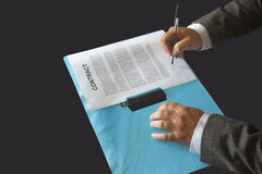 Man signs contract Stock Photo