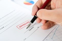 Man signs the contract with pen. Approved stamp on document Royalty Free Stock Photos