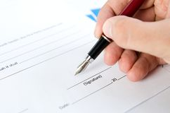 Man signs the contract with pen. Document certificate contract agreement lawyer hand concept Royalty Free Stock Image